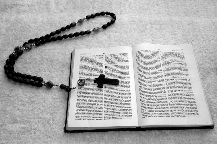 image showing a cross over a bible for the exorcism of anneliese michel